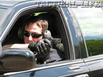 8-joe-shooting-from-car