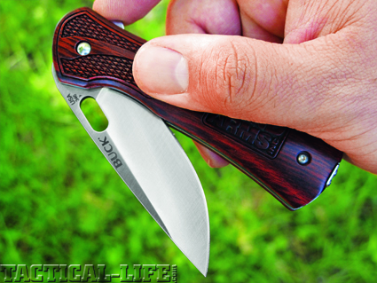 The Bond Arms knives could be opened one of two ways. Either with the elongated one-hand-opening hole in the blade, or via the flipper, which protrudes from the spine of the knife while it's folded.