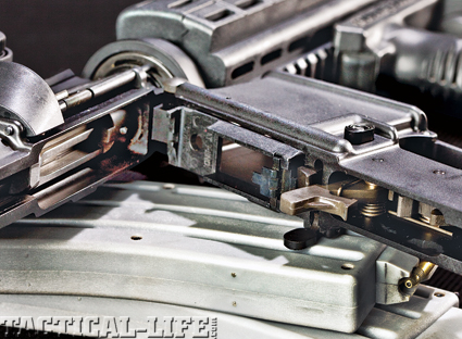 The M4-LE22 employs a mag adapter for use of .22 mags and features a bolt stop that locks the gun open when empty.