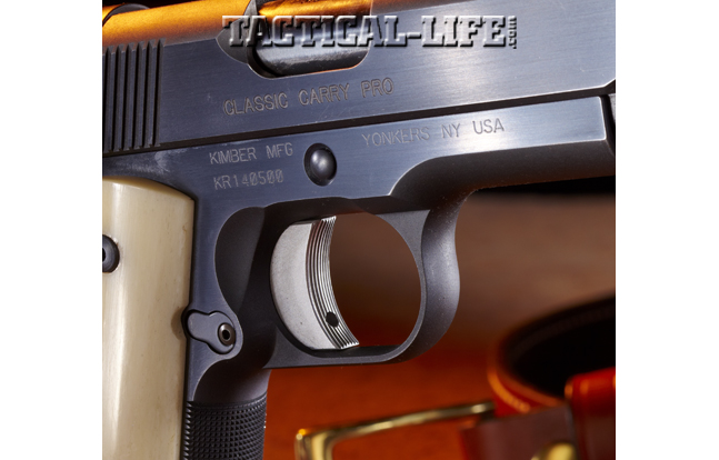 The slide stop pin is recessed and surrounded by a beveled opening. The serrated face of the single- action trigger is specific only to this model.