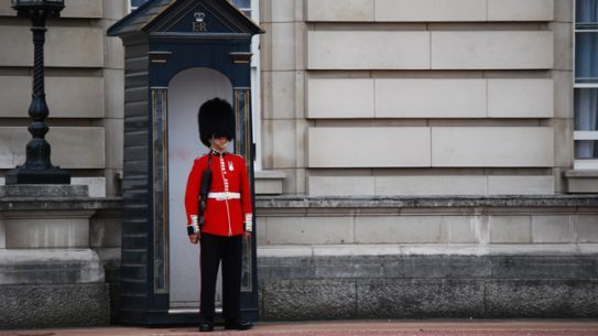 Officials arrest a man with a knife at Buckingham Palace.