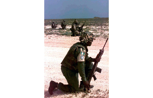 Nigerian troops in Somalia patrol with the FN FAL.