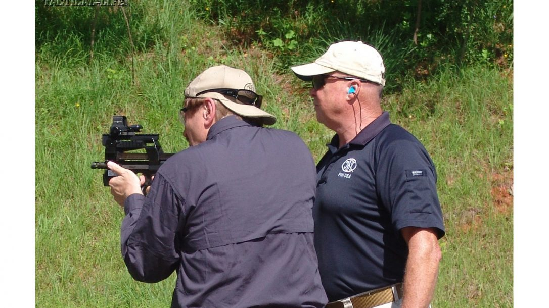 Tactical-Life Visits FNH USA - The author and Bucky Mills with a FNH P90.