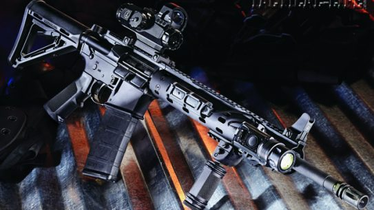 The Daniel Defense M4 V7 in 5.56mm combines a mid-length gas system with a unique modular rail system with movable 3-inch sections of Picatinny rail. It is shown equipped with a Leupold HAMR 4x24mm optic, SureFire M720V light and B&T Industries foregrip.