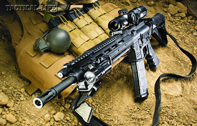 The Ruger SR-556 Carbine is a light, sleek 5.56mm that would be a perfect addition to any patrol unit or SWAT team. Its adjustable gas piston system helps it run reliably in adverse conditions. Shown with a Magpul CTR stock, Inforce WML and Leupold VX-R Patrol 1.25-4x20mm scope.