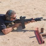 SureFire at the Range | New Products for 2014 - Mike Voight using magazine as rest from prone