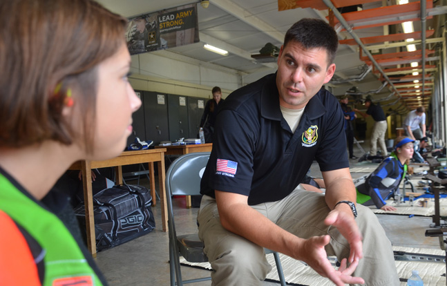 Staff Sgt. Michael McPhail, U.S. Army Marksmanship Unit rifle shooter and 2012 Olympian, talks to a camper during the 2013 USAMU Advanced Junior Rifle Camp. Applications for the 2014 camp are now being accepted. (USAMU photo)
