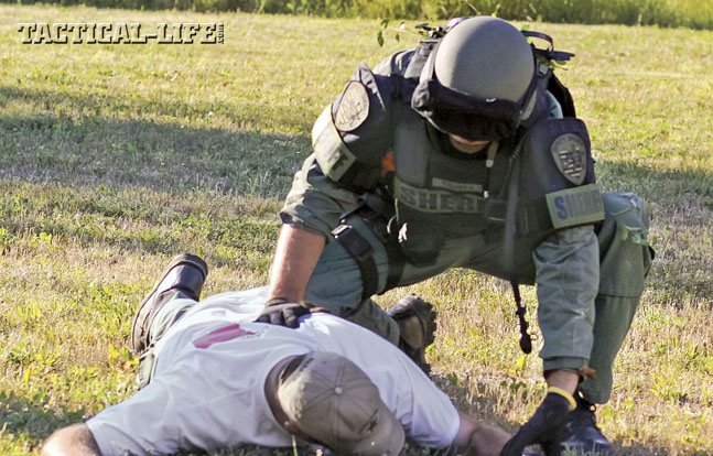 The Special Response Team trains hard to make arrests quickly and safely. Here an operator controls a downed suspect.