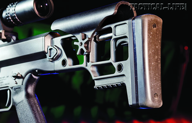 The skeletonized, folding stock locks over the bolt handle to keep it secure and reduce the MRAD's width.