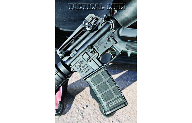 Colt's AR-15A4 is an amalgam of the old and the new. Note the standard hinged triggerguard, A2-style pistol grip and Magpul PMAG.