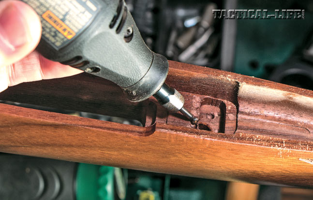 To glass bed the recoil lug, you will need to remove some wood to make room for the Acraglas. This is done with a Dremel tool.