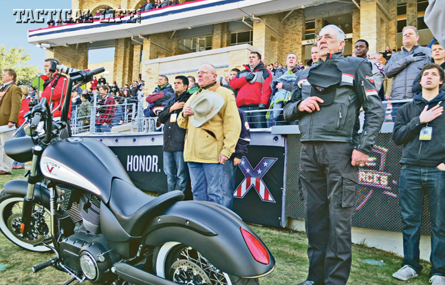 The Gunny stands at attention during the national anthem at the Armed Forces Bowl in December 2012. Every year he promotes the football game on TV and radio for the military teams that play in it.