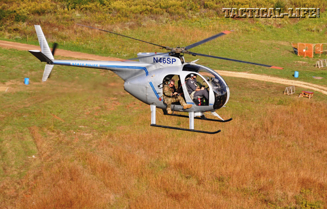A student engages a target from the Kentucky State Police's OH-6 helicopter at a speed of 40 knots and an altitude of 100 feet.
