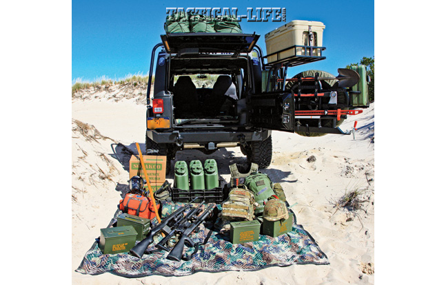 The Jeep's bug-out kit includes fuel cans, food rations, ammo, several firearms, body armor, Kevlar helmets, assorted tools and much more.
