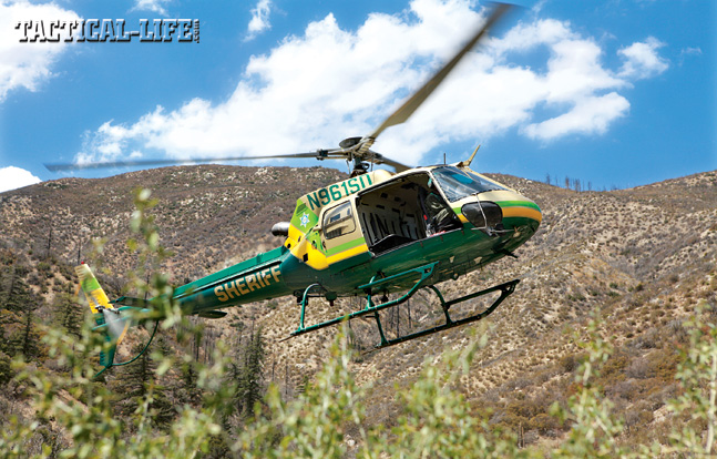 The Los Angeles County Sheriff's Department's Eurocopter maintained overwatch while the MET searched the illegal growing operation. Then the helo was used to airlift out the cut marijuana, hazardous chemicals and debris.