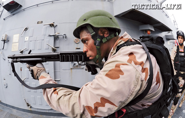 Every branch of the U.S. armed forces uses Remington 870 shotguns in some form or another. Here Navy sailors use 870s for ship-clearing operations.