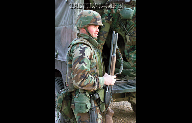 U.S. Marine with 4th Force Service Support Group (FSSG) holds on to a Remington 870 12 gauge during the 2002 Steel Knight exercise in California.
