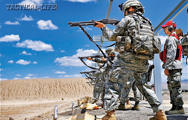Members of the Nevada Air National Guard undergo shotgun practice with their Remington MCS shotguns, which feature Picatinny rails for mounting optics and were designed to accept interchangeable barrels and stocks, making one shotgun suitable for several missions.