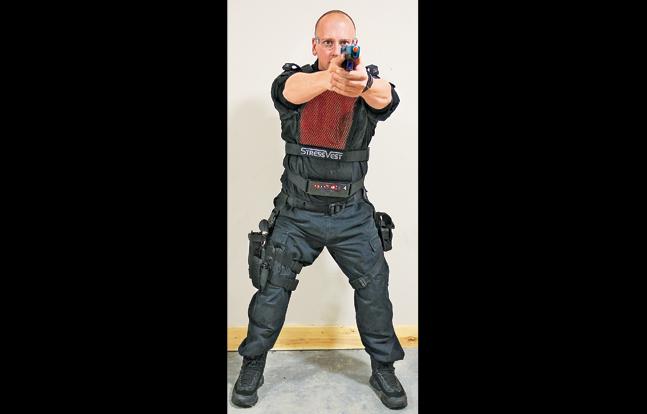 Officers work together in close quarters wearing Setcan's entire force-on-force laser training system, including the StressVest with side panels, the StressX Training Belt and laser pistols.