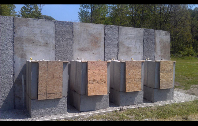 High Volume Shooting Range with Expendable SACON Bullet Traps, Wood Target Hangers and SACON T-Panel Backstop.