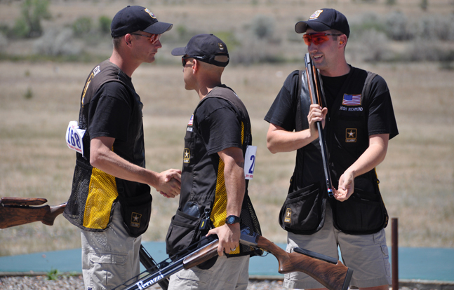 U.S. Army Marksmanship Unit Soldiers Staff Sgt. Glenn Eller (left), Staff Sgt. Josh Richmond (center), and Staff Sgt. Jeff Holguin (right) prepare to compete at a match last year. The three USAMU Shotgun shooters qualified to represent the country on the U.S. National Shooting team at the International Shooting Sports Federation World Championships in the fall. The three shotgun shooters swept the podium at the USA Shooting Spring Selection match March 23 in Kerrville, Texas in Men's double trap.