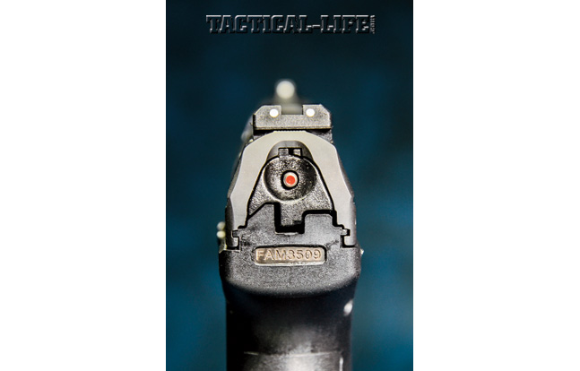 The P99's red loaded-chamber indicator may be readily seen or felt in the dark. Also note the white-dot front and rear sights, which are very easy to acquire.