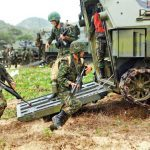 ROK Marines charge out of their assault vehicles during a training exercise in Thailand with U.S. Marines. They appear to have been loaned M16s by the U.S. troops.