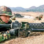An ROK Marine armed with a K2 rifle with a 40mm grenade launcher attached. Note the brass catcher attached to the rifle.