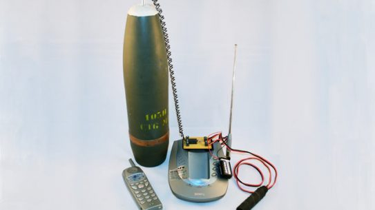 Improvised Electronics uses realistic simulated IEDs to give EOD trainees a feel for what they'll face in the field. Here a 105mm artillery shell's detonator is rigged to a telephone, ready to blast when dialed.