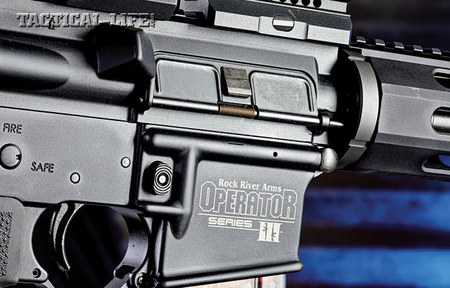 The Operator III features a forged upper receiver for strength and durability. Note the shell deflector and hinged dust cover door.
