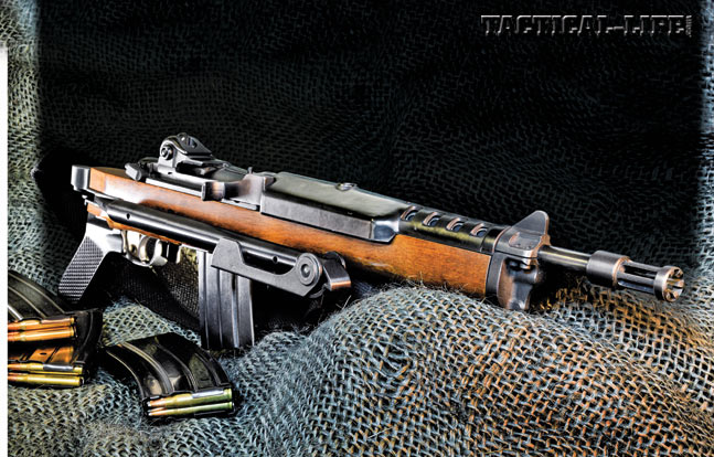 Ruger's AC-556, shown with its stock folded, is a compact, select-fire carbine packing 5.56mm firepower. The AC-556 became known globally for its controllability. Even in full-auto, there is little muzzle rise.