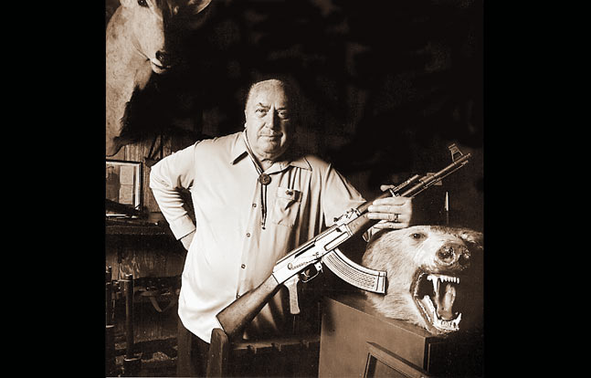 Colonel Rex Applegate on page 7 of his book The Close-Combat Files of Col. Rex Applegate poses in his trophy room with one of his other legendary rifles.