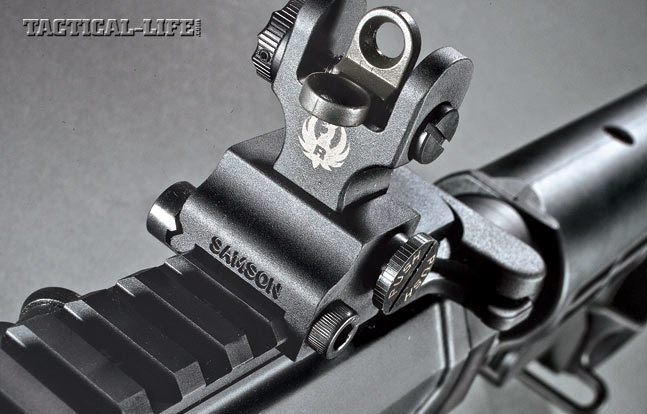 The rifle comes with folding backup iron sights, including a windage-adjustable rear sight