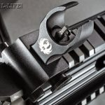 The rifle comes with folding backup iron sights, including an elevation-adjustable front sight