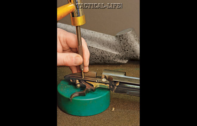 OUT WITH THE OLD: Remove the old trigger, including all the springs. Remove the bolt stop and the bolt stop spring. The bolt stop spring is under tension, so be careful not to lose it. Replace the bolt stop and bolt stop spring, but only push the pin in far enough to hold them and not block inserting the trigger.
