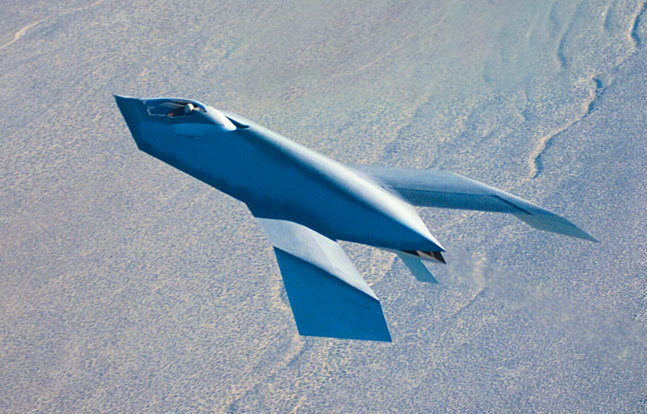 A photo of the actual Bird of Prey technology  demonstrator in flight over high desert in Nevada.