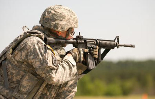 Staff Sgt. Christopher M. Dedrick, a small group leader at the Fort Dix Non-commissioned Academy, shoots an M4A1 during the M4A1 qualification event at the 2012 Regional Best Warrior Competition here June 5. (Photo by: Spc. True Thao)