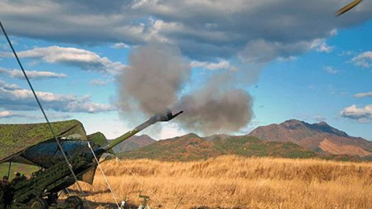 Marines fire an M777A2 Howitzer