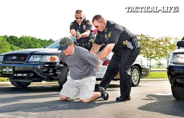 Handcuffing is best done with two officers. The restraining LEO approaches with their sidearm secured while a partner provides cover.
