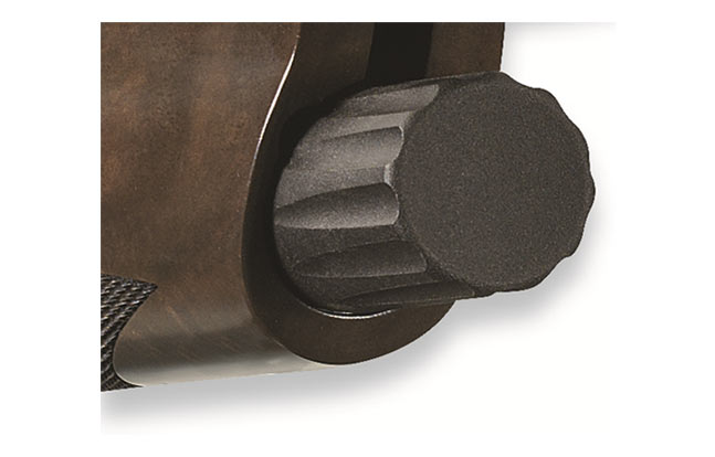 Synthetic bushing incorporated into magazine cap prevents the cap from binding under all environmental conditions, including dust, dirt, moisture and freezing temperatures.