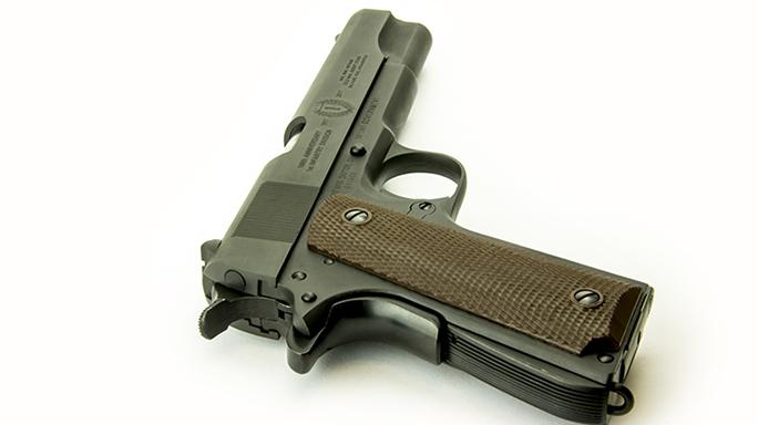 Inland M1 Carbine and 1911a1 handgun rear