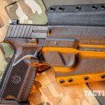FN 509 pistol in holster