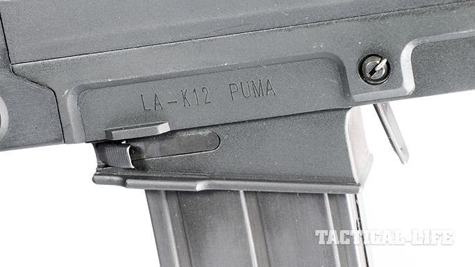 LA-K12 Puma shotgun bolt release