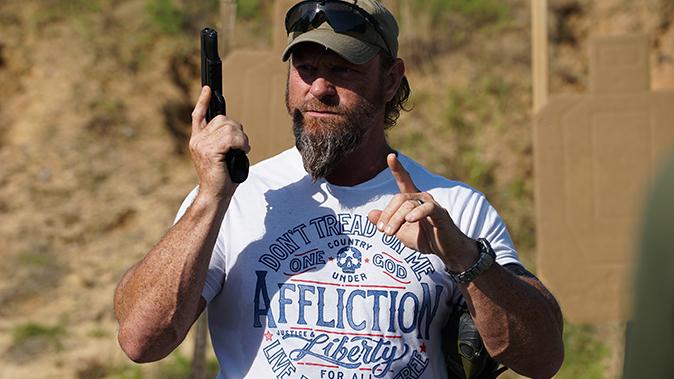 train like you fight pat mac holding gun