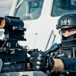 Aimpoint CompM5 MPS3 sight attached to heavy machine gun