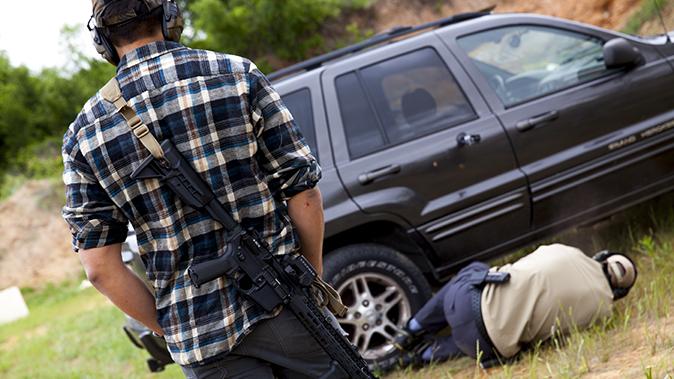 aaron barruga police shootout rifle on back