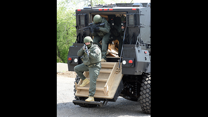 mrap vehicle police exiting