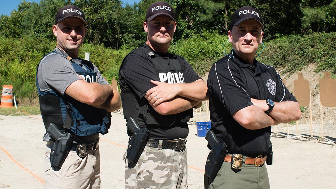 ocean view police officers posing