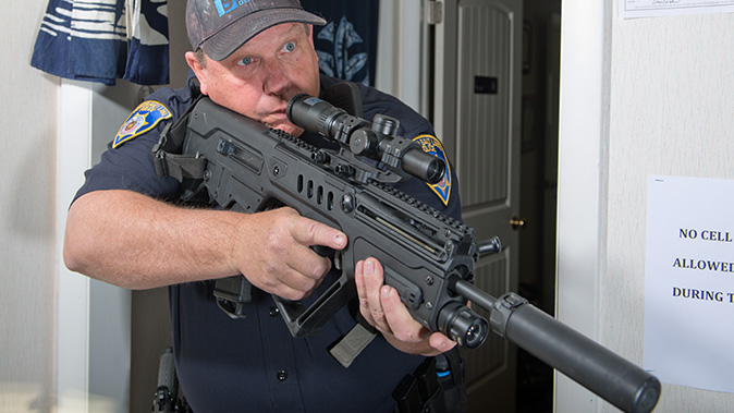 low-powered optics rifle pose