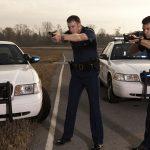first responder driving guns drawn